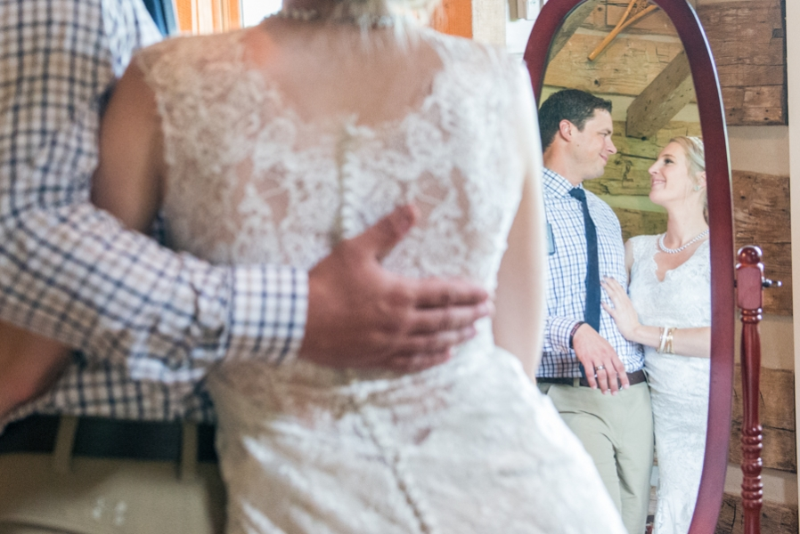 newlyweds_reflection_in_red_framed_mirror.jpg