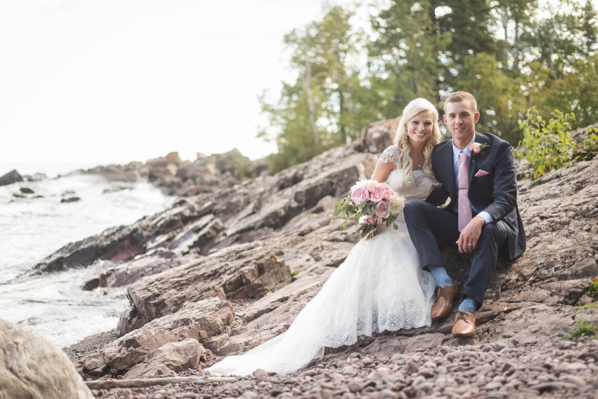 newlyweds_sitting_on_giant_rocks_on_lake_superior.jpg