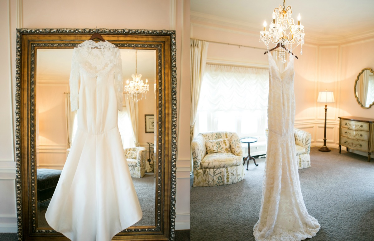 off_white_wedding_gown_with_lace_sleeves_and_straps_hanging_up_in_elegant_bridal_suite_gold_frame.jpg