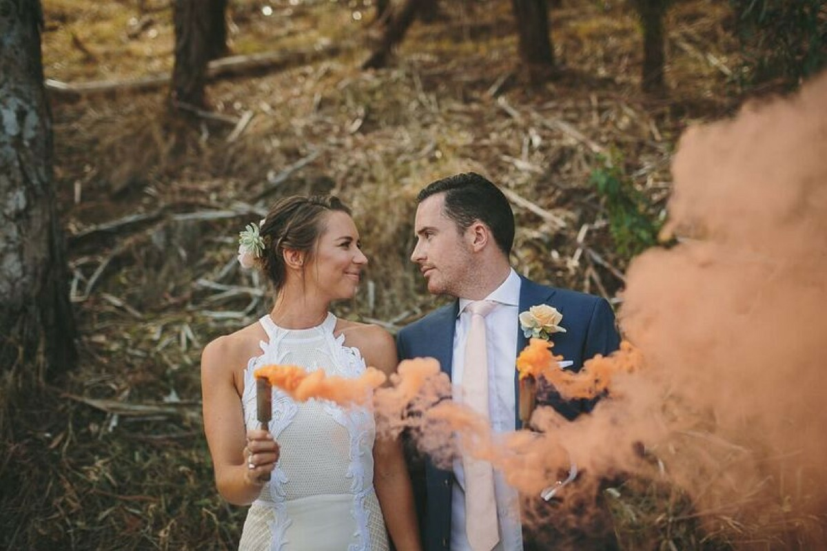orange_smoke_bride_and_groom.jpg