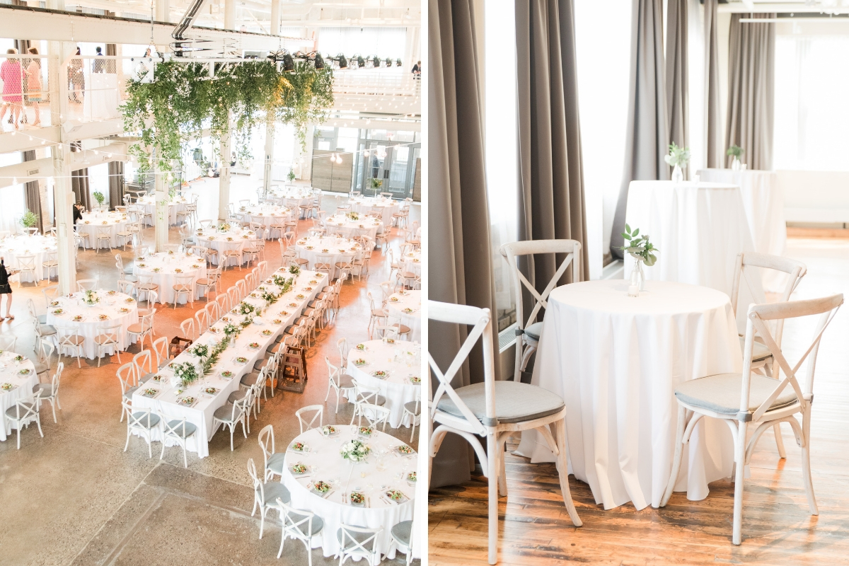 overview_of_industrial_style_wedding_venue_dinner_tables_white_with_green_flowers_natural_light.jpg