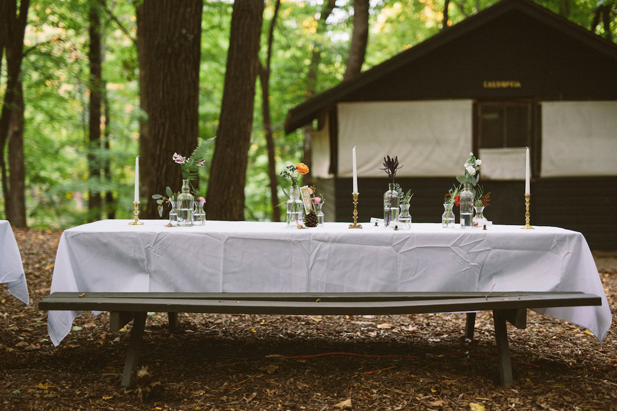 picnic_table_at_vintage_camp_wedding_with_wedding_decor.jpg