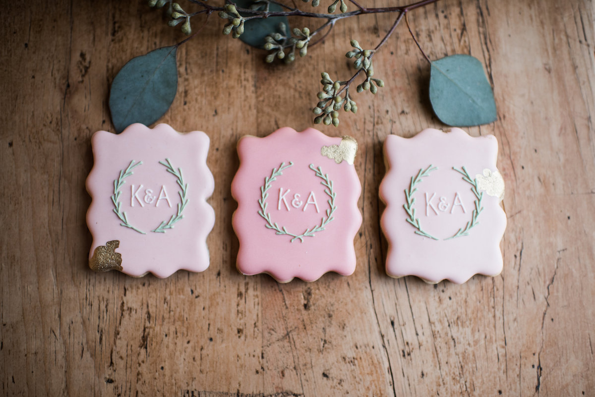 pink_wedding_cookies_on_wood_with_flowers.jpg