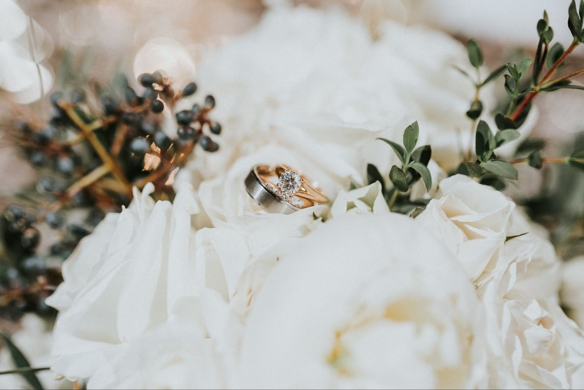pretty_close_up_of_rings_sitting_on_white_flowers.jpg