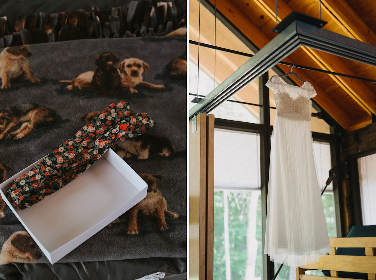red_floral_tie_in_box_wedding_dress_hanging_in_cabin.jpg