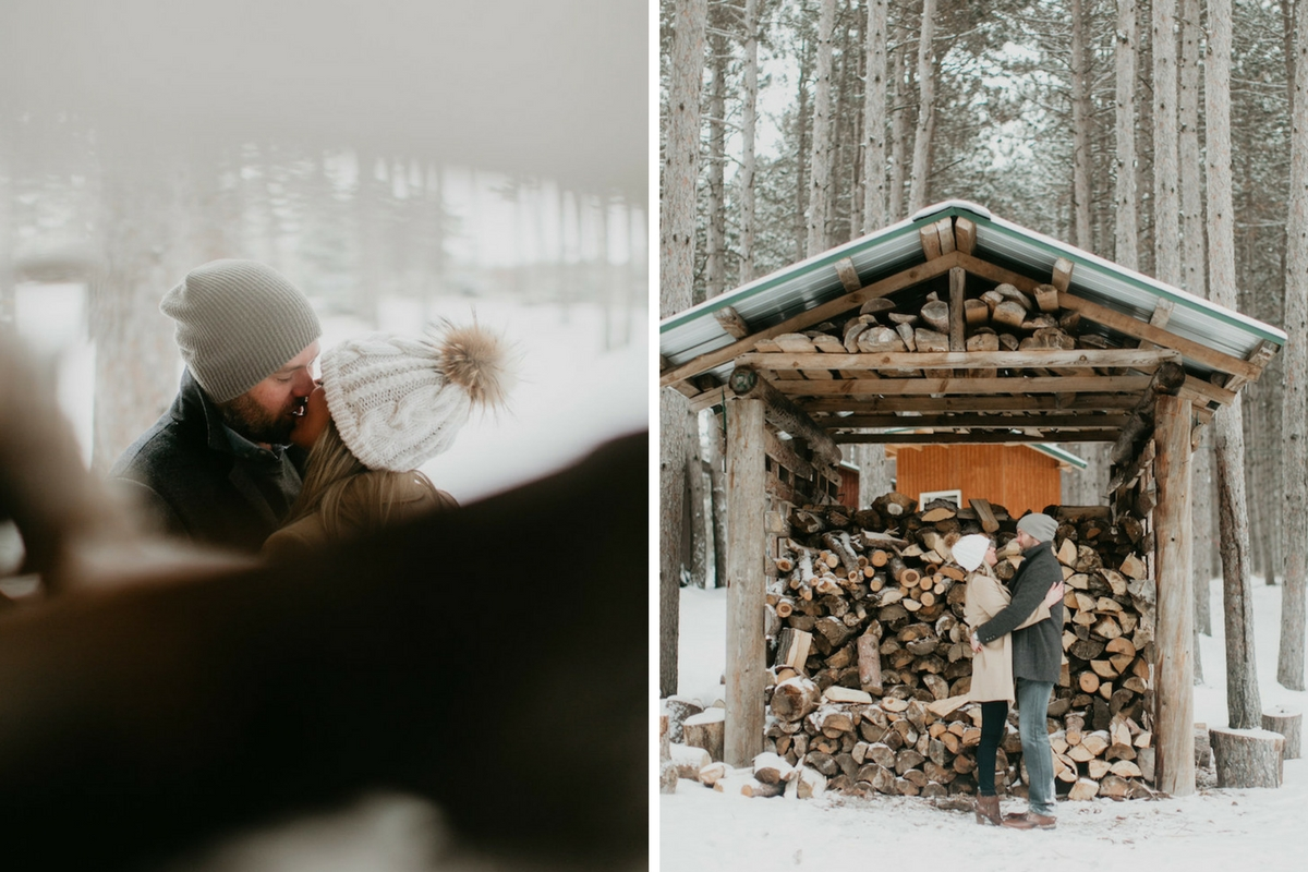 romantic_couple_kissing_by_log_stack_in_snowy_woods.jpg