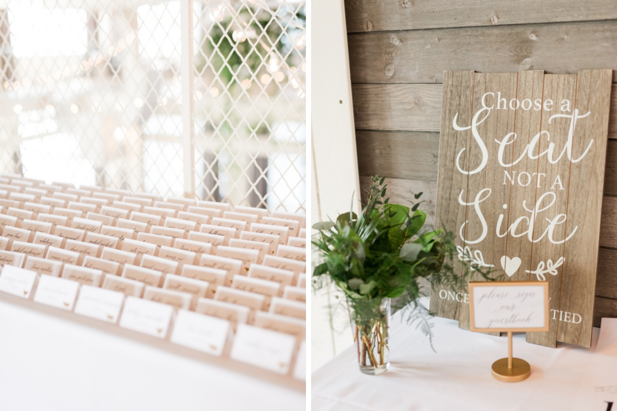 rustic_wooden_wedding_sign_with_white_lettering_and_seating_placecards_lined_up.jpg
