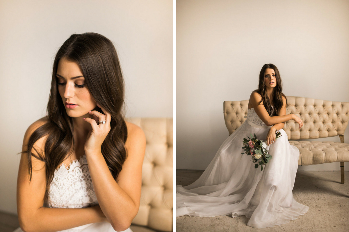 serious_bride_looking_down_sitting_on_tan_chair_holding_bouquet.jpg