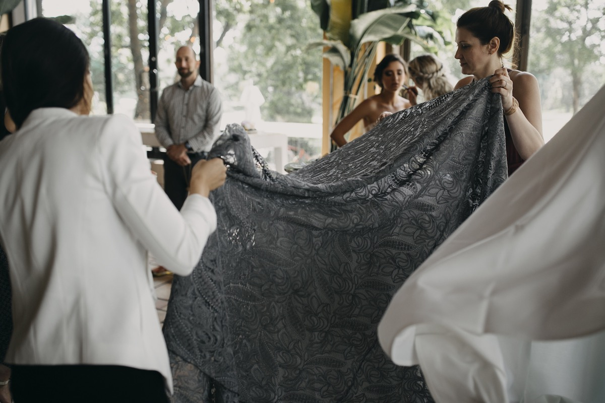 setting_up_gray_lace_tablecloth.jpg