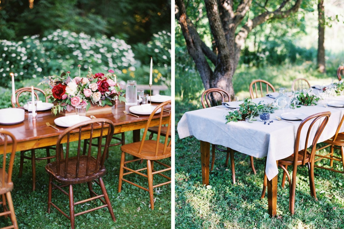 side_of_wooden_table_outdoor_reception_red_flowers.jpg