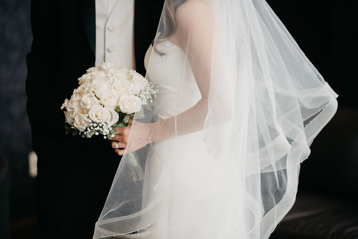 side_view_of_bride_and_groom_bridal_bouquet_wedding_veil.jpg