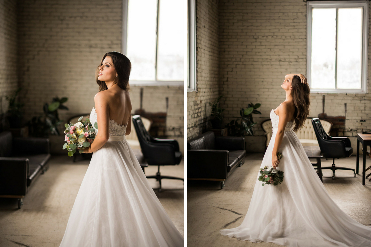 side_view_of_stunning_bride_holding_bouquet_in_industrial_white_building.jpg
