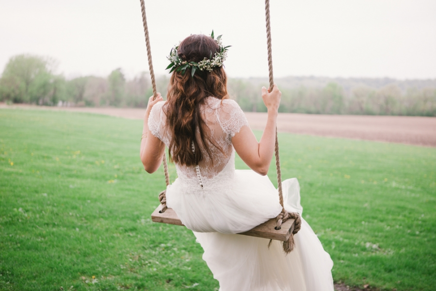 simple_boho_bride_swinging_on_swing_with_ecalyptus_flower_crown_lace_gown.jpg