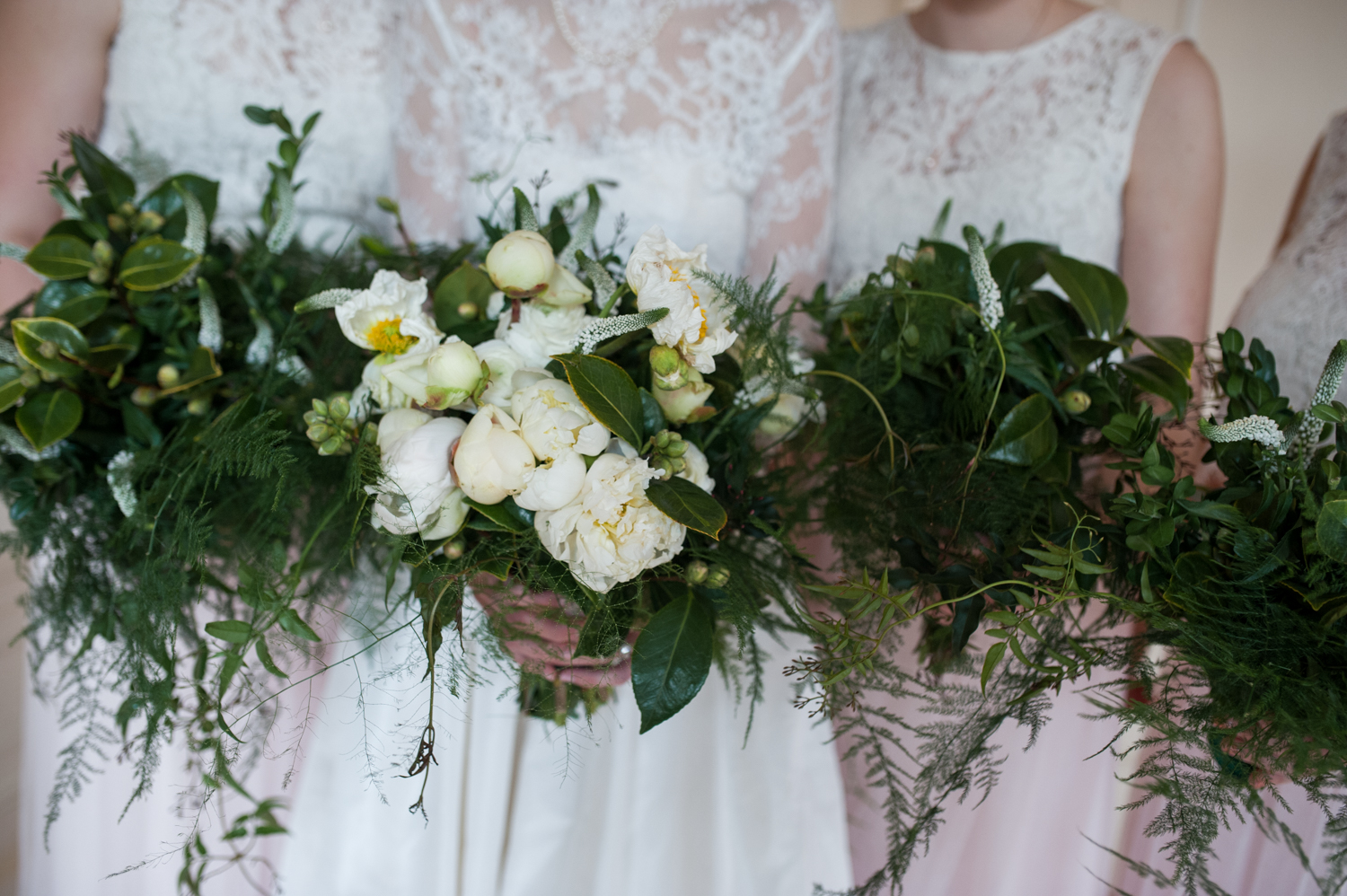simple_bridal_bridesmaid_bouquets_greenery_white_flowers.jpeg