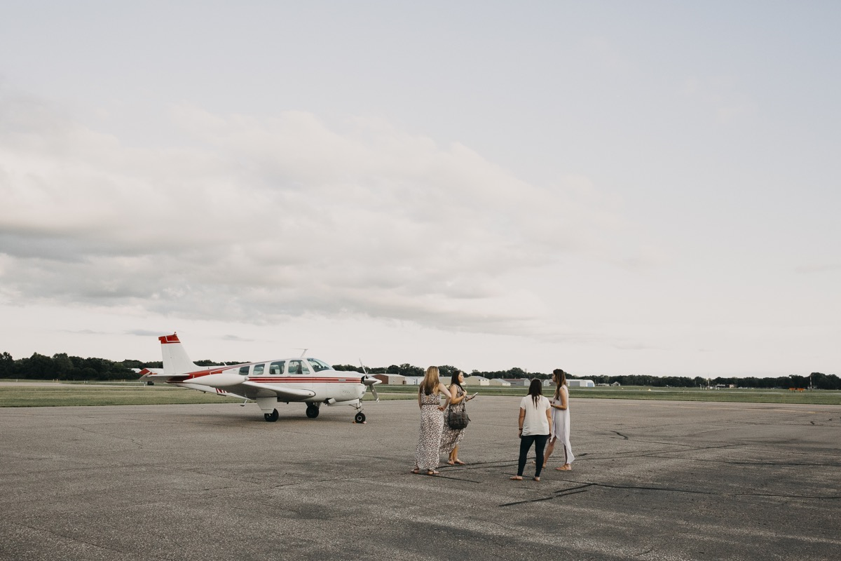 small_airport_wedding_styled_shoot_talking_by_plane.jpg