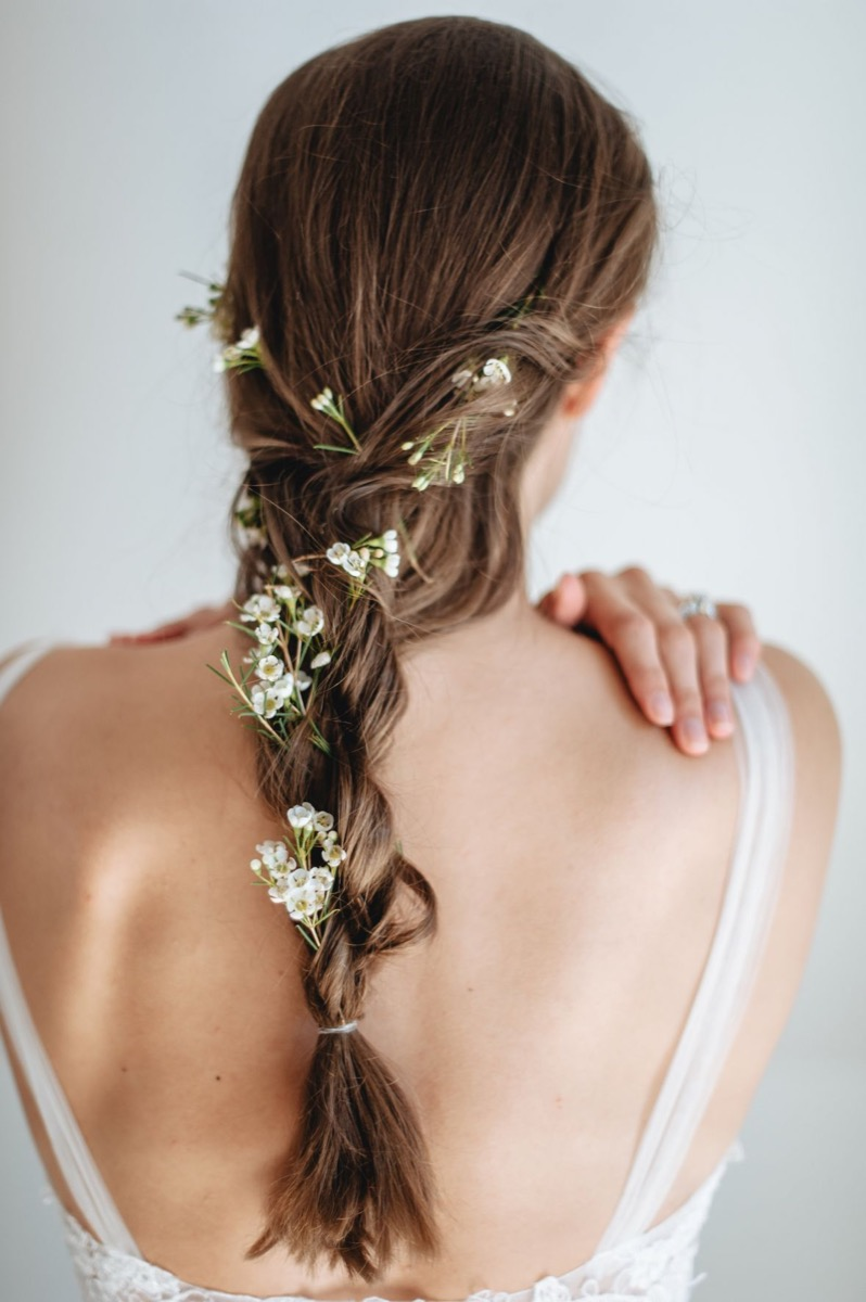 small_white_flowers_in_brides_hair_simple_braid.jpg