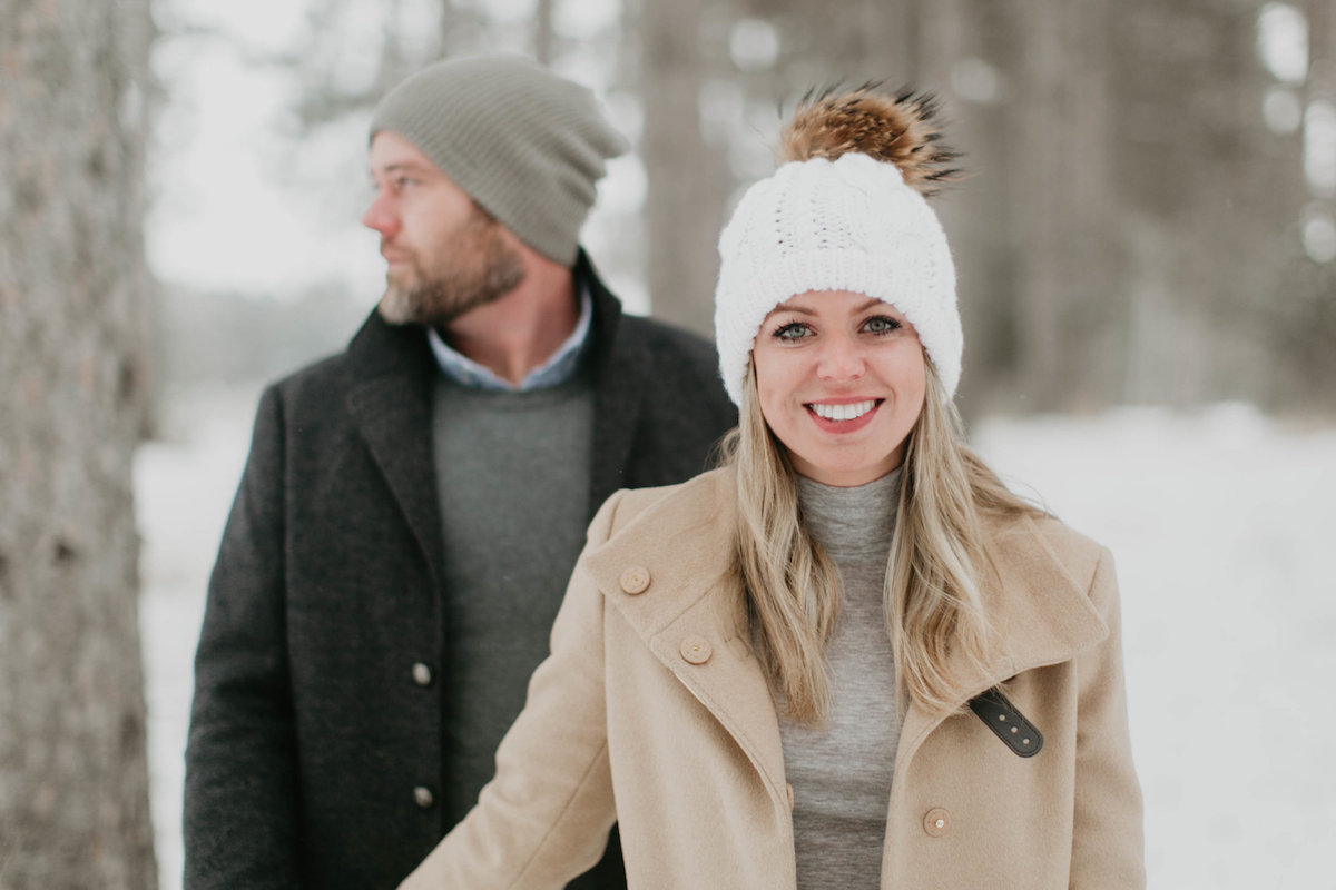smiling_couple_in_winter_woods.jpg