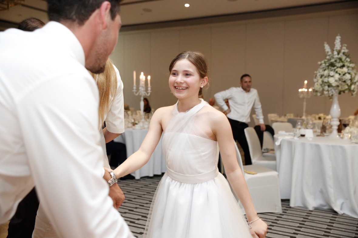 smiling_flowergirl_on_dance_floor.jpg