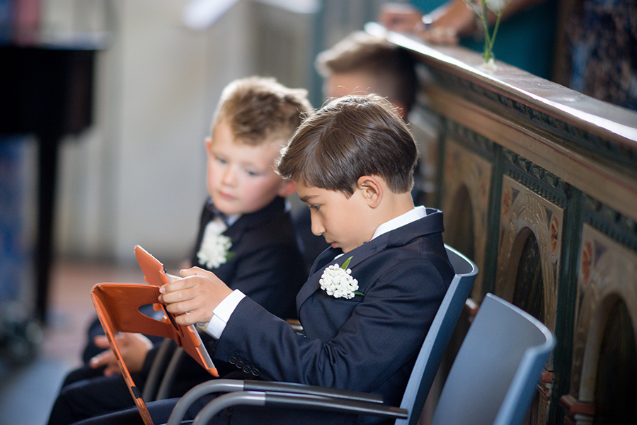 sons_ring_bearers_playing_on_ipad_during_ceremony.jpg