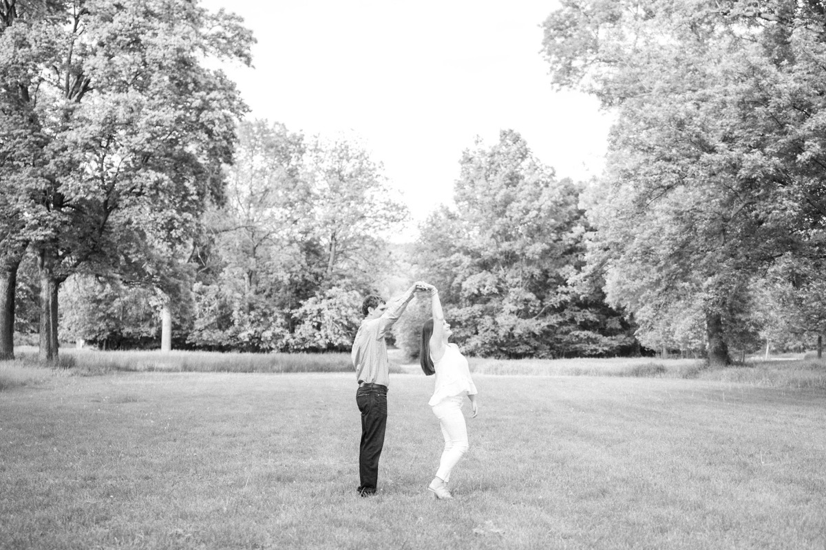 spinning_in_field_engagement_black_and_white_photo.jpg