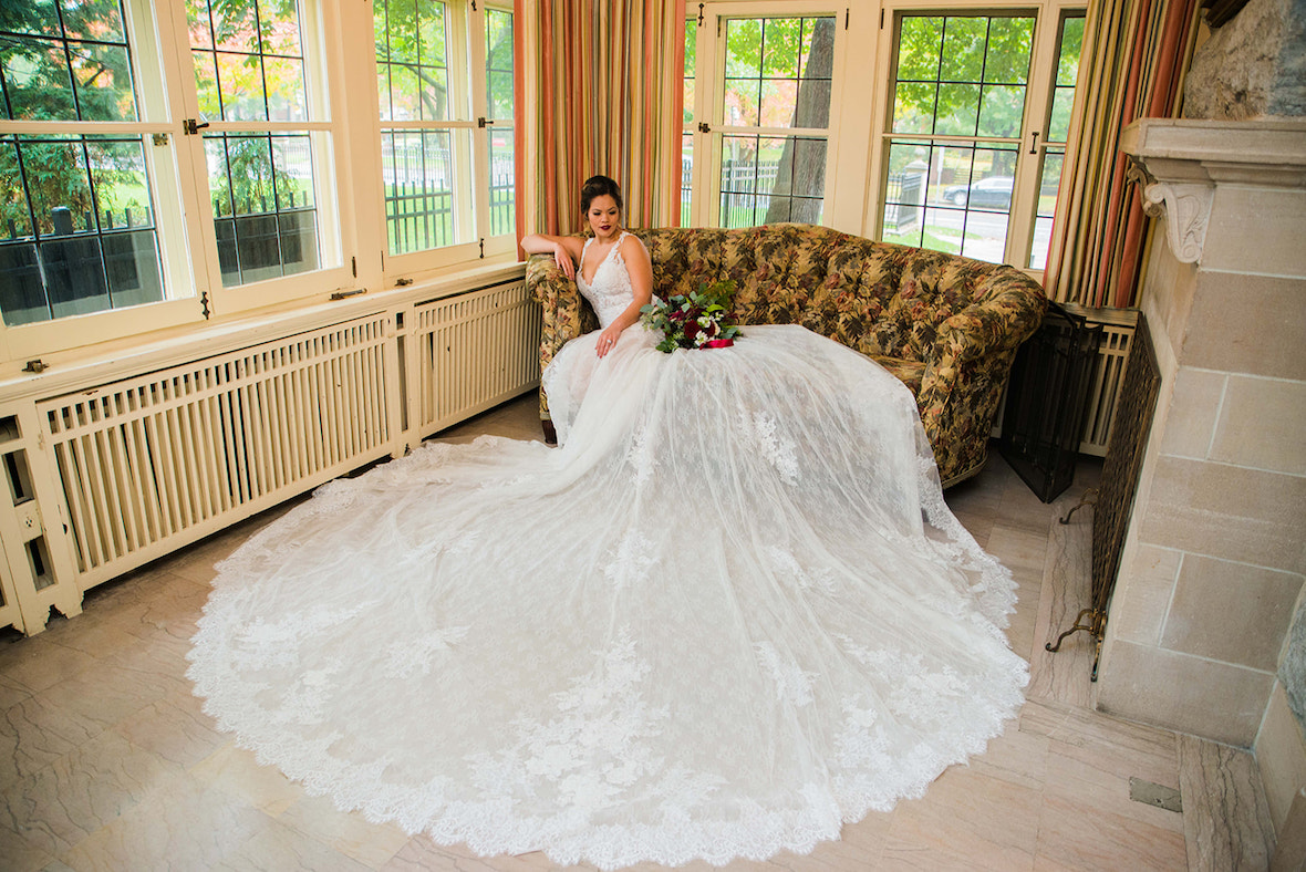 stunning-bride-in-dress-on-couch.jpg