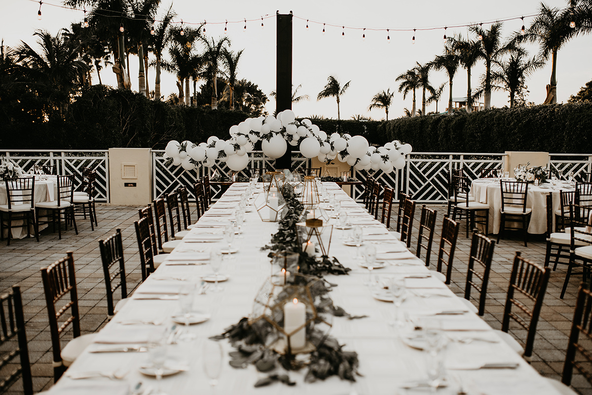 stunning_white_and_brown_florida_wedding_reception_on_patio.jpg