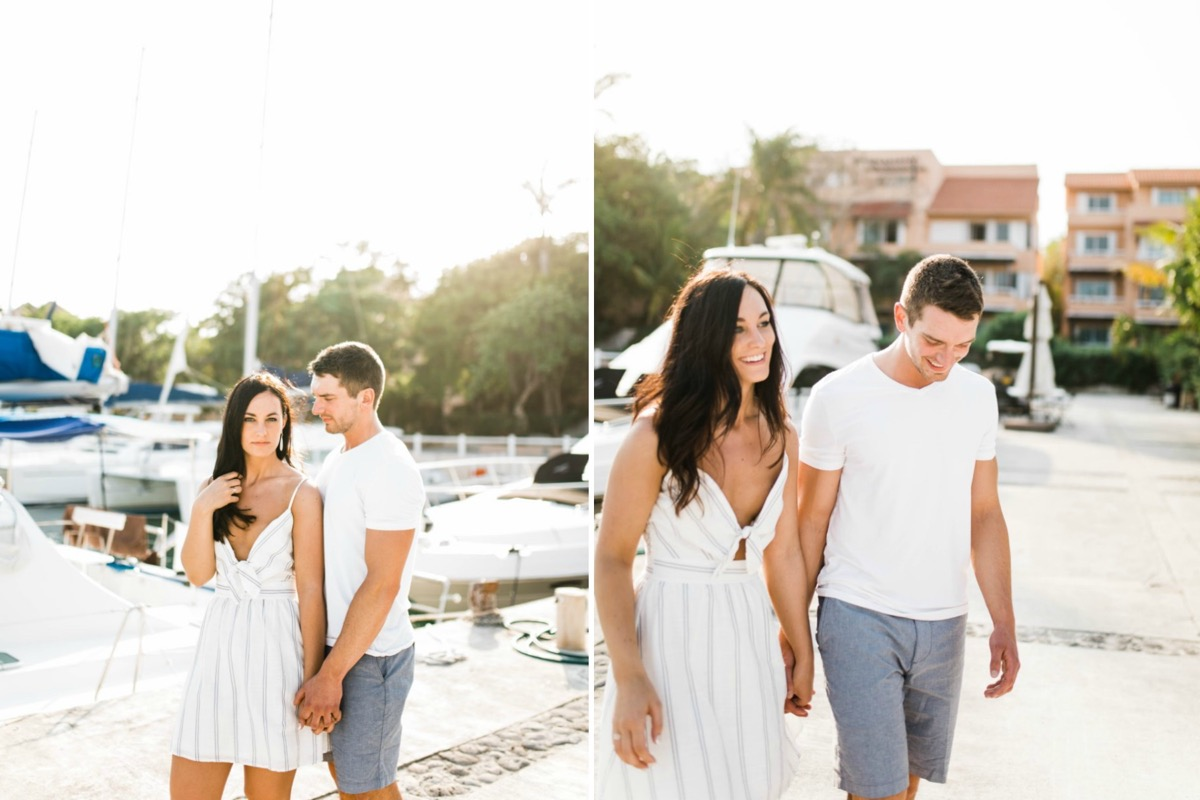 sunny_portraits_couple_posing_by_boats_mexico_engagement.jpg