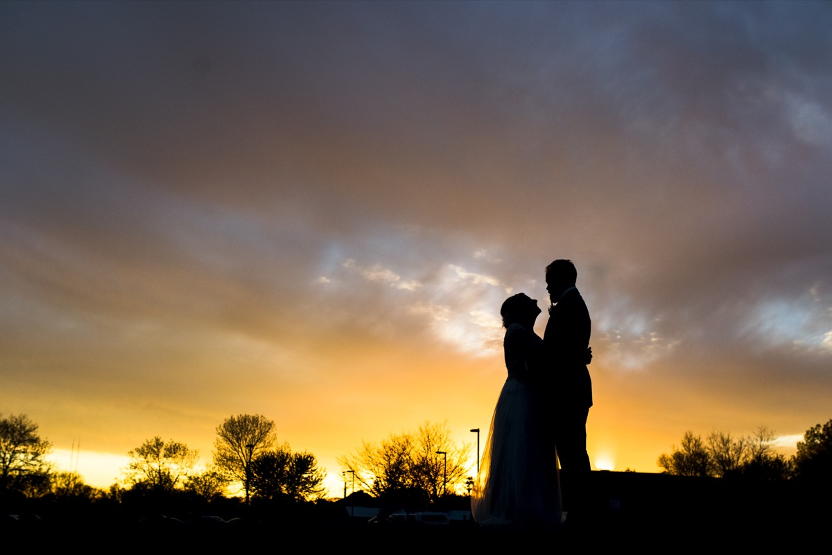 sunset_wedding_day_orange_glow_sky_dark_silouhette_newlyweds.jpg