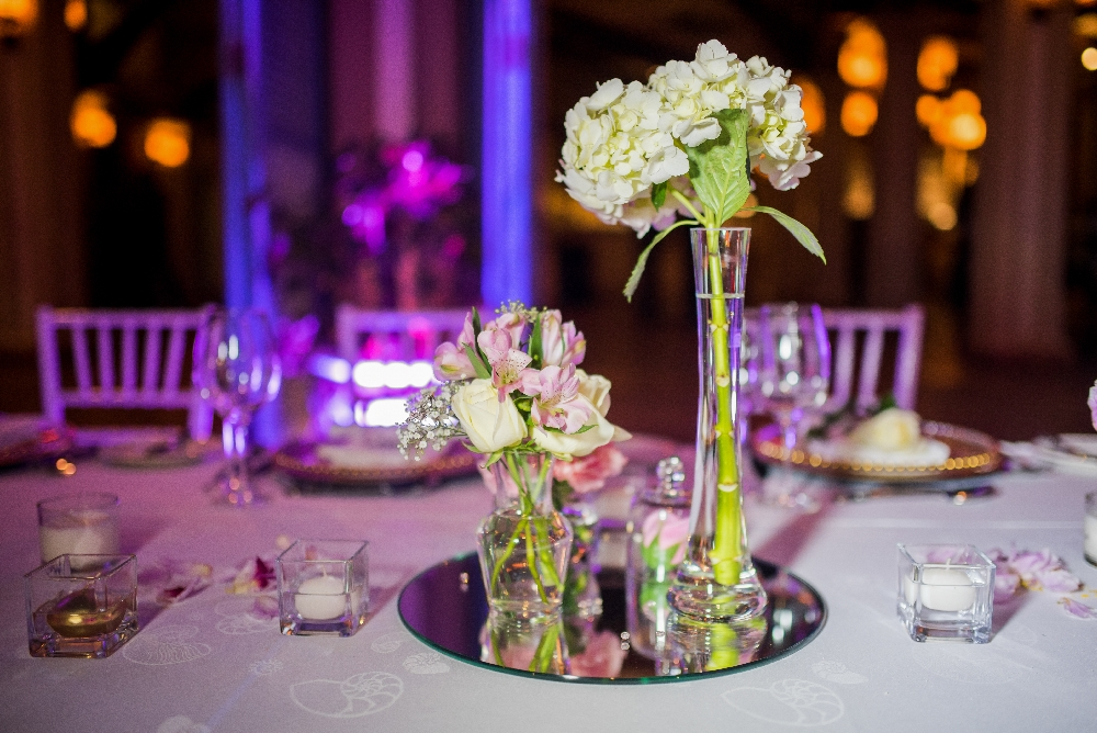 table_centerpieces_floral_cases_mirror_plate.jpg