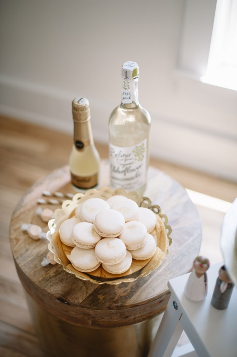 taffy_macaroons_champagne_sitting_on_table_in_white_room.jpg