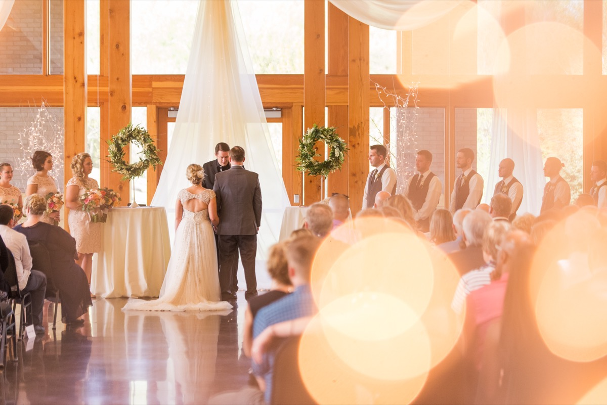 tall_ceiling_wooden_beams_white_curtain_drape_wedding_venue_mn.jpg