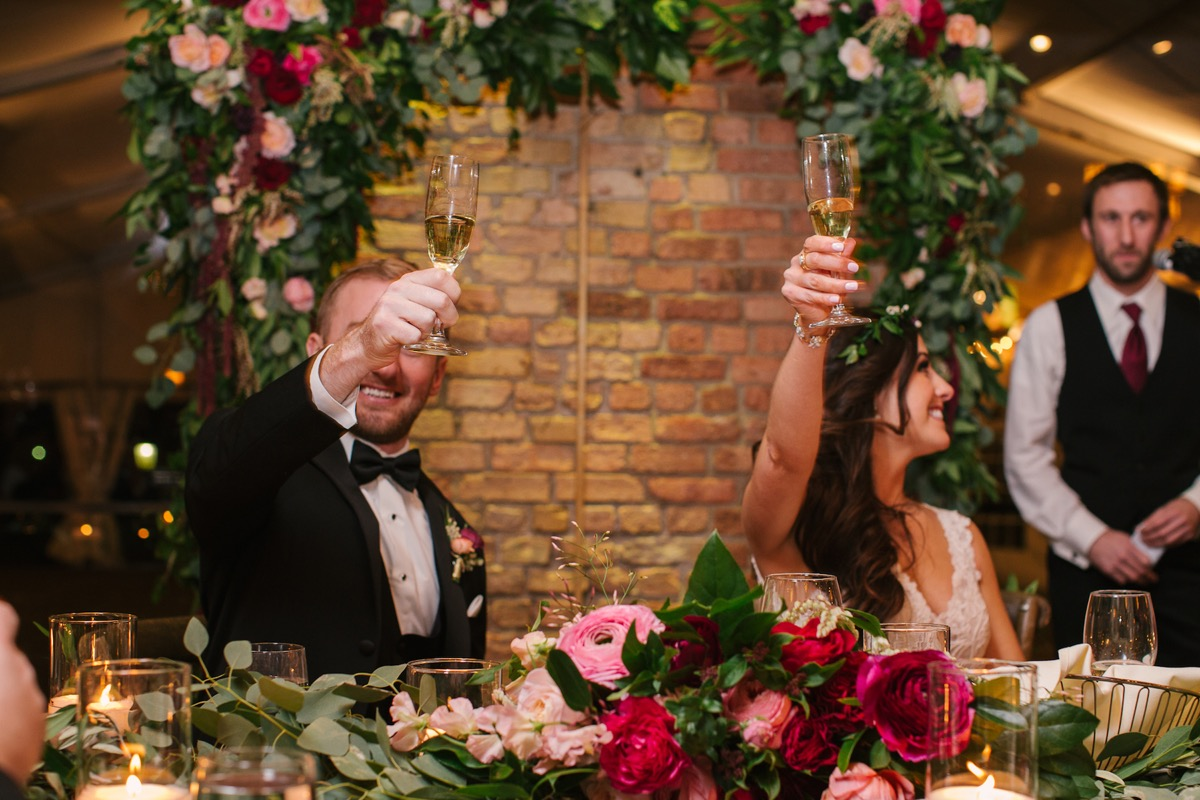 toasting_wedding_reception_speeches_holding_up_champagne_glasses.jpg
