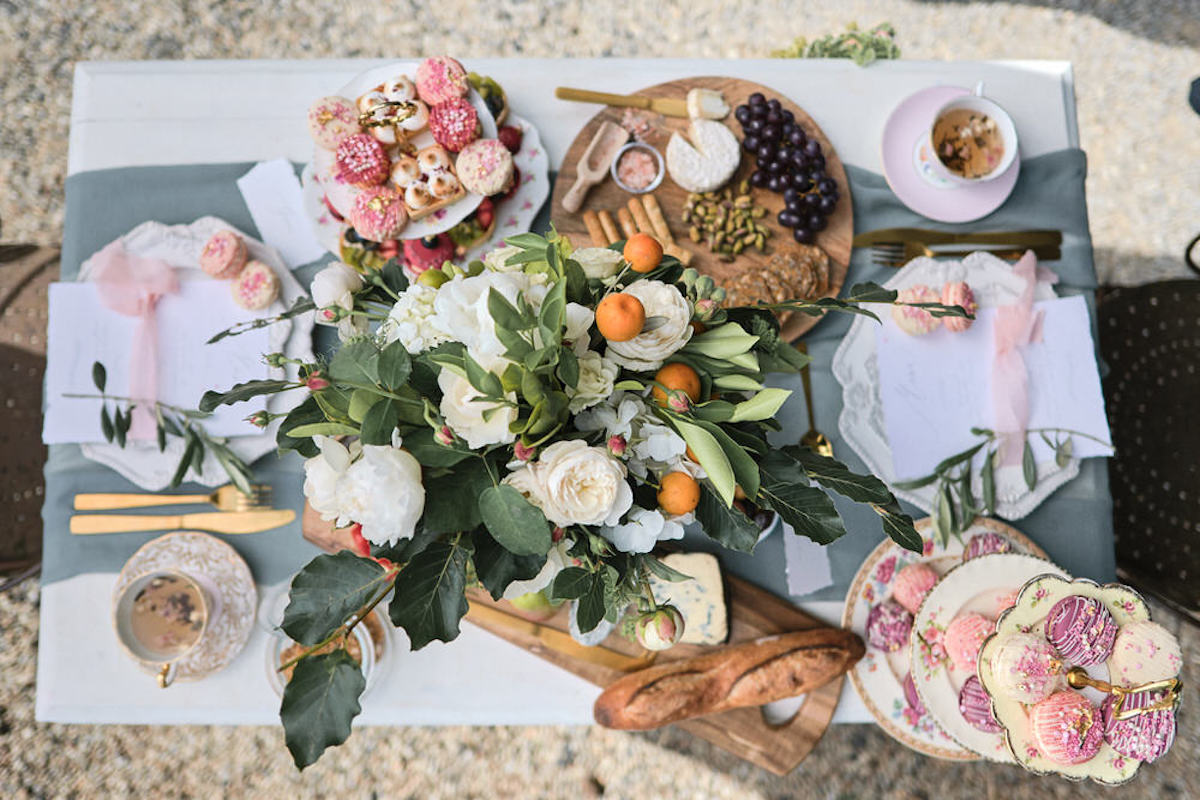 top_view_of_french_style_wedding_lunch_large_florals_and_desserts.jpg