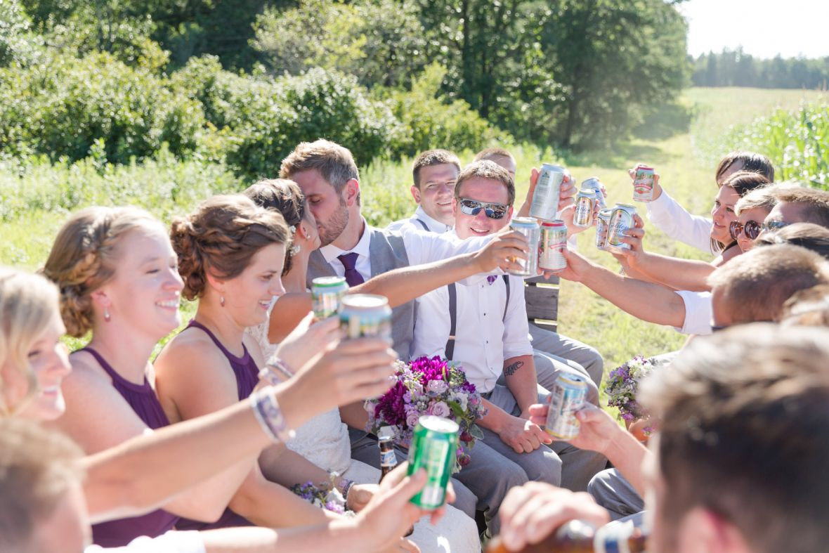 tractor_ride_wedding_party_cheers_with_beer.jpg
