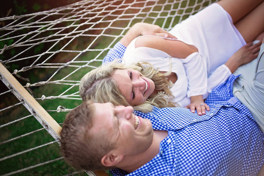 tropical_engagement_photos_couple_laying_on_hammock.jpg
