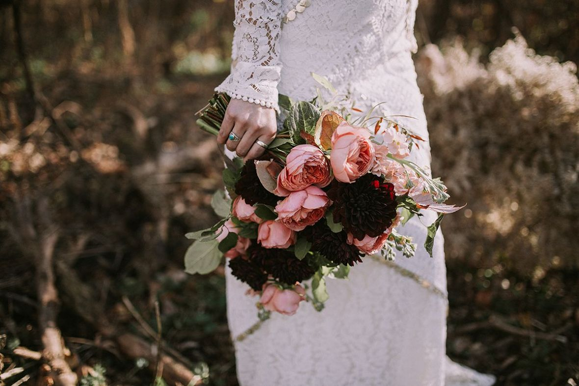 turquoise_ring_bride_lace_dress_carrying_bouquet_dark_reds.jpg
