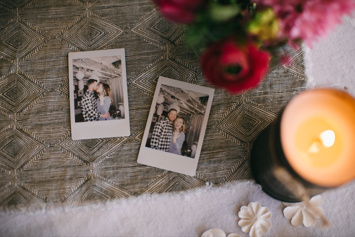 two_polaroid_pictures_on_table_runner_of_engagement.jpg