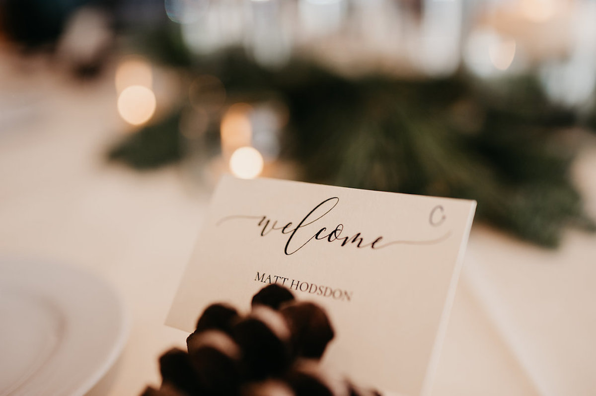 up_close_details_of_pinecone_placecards_at_winter_wedding.jpg
