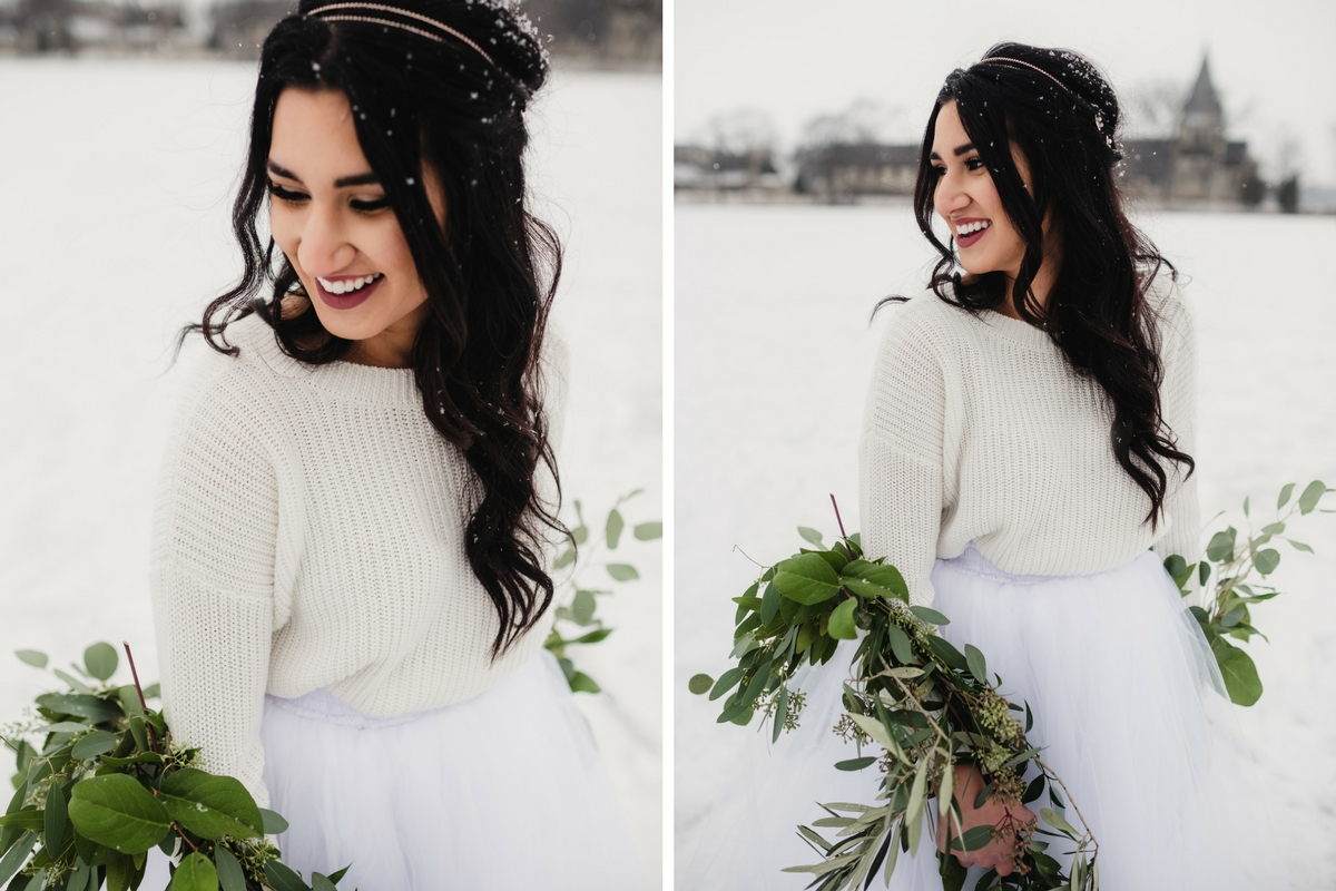 up_close_winter_bride_in_snowy_park_holding_greenery.jpg