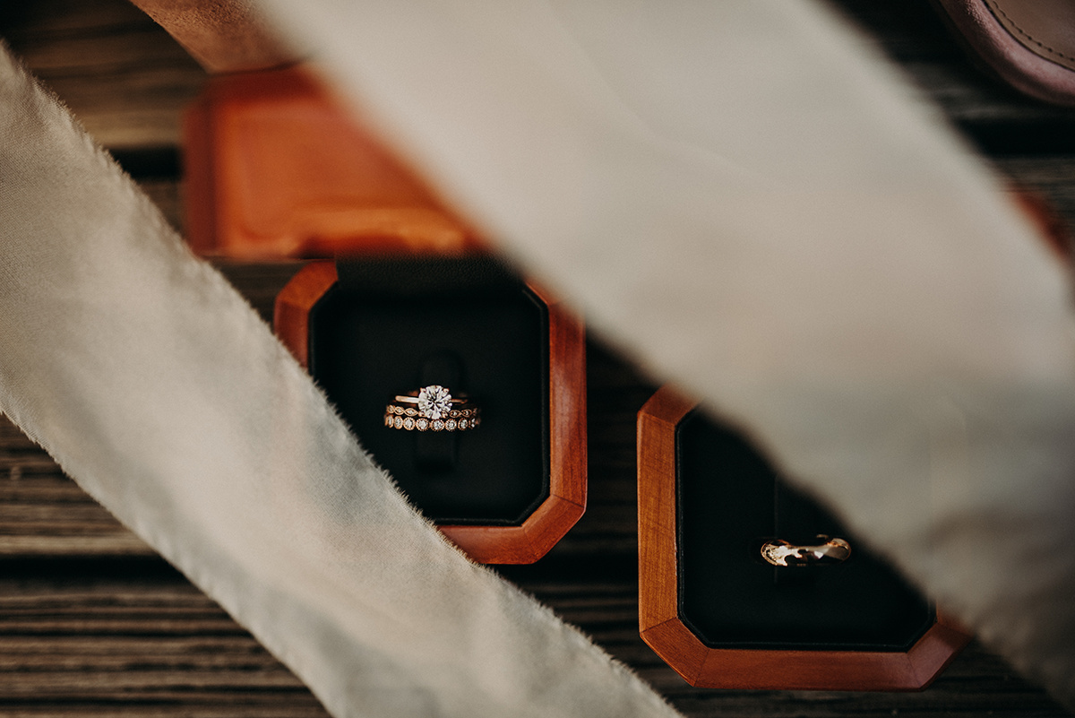 wedding_bands_in_wood_ring_boxes_with_ribbon.jpg