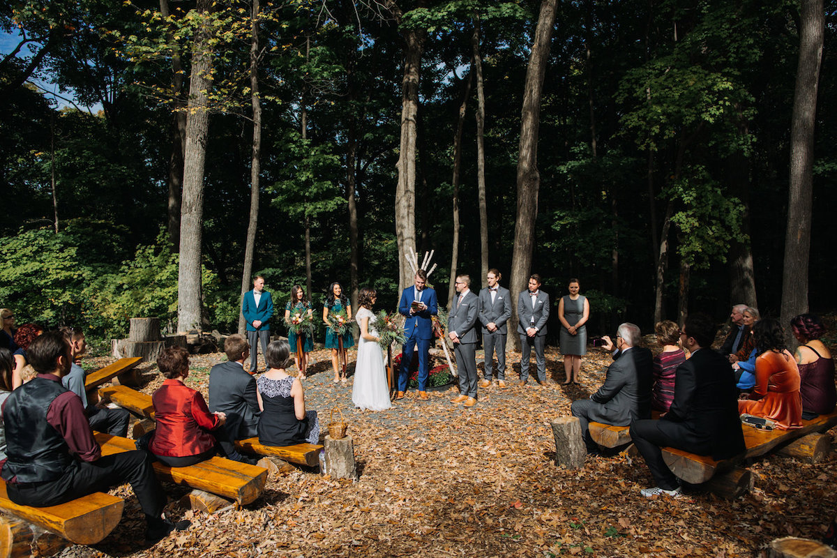 wedding_camp_in_woods_ceremony_leaves_on_ground.jpg