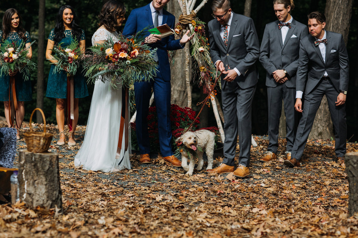 wedding_camp_woods_ceremony_autumn_leaves_floral_bouquets_white_puppy.jpg