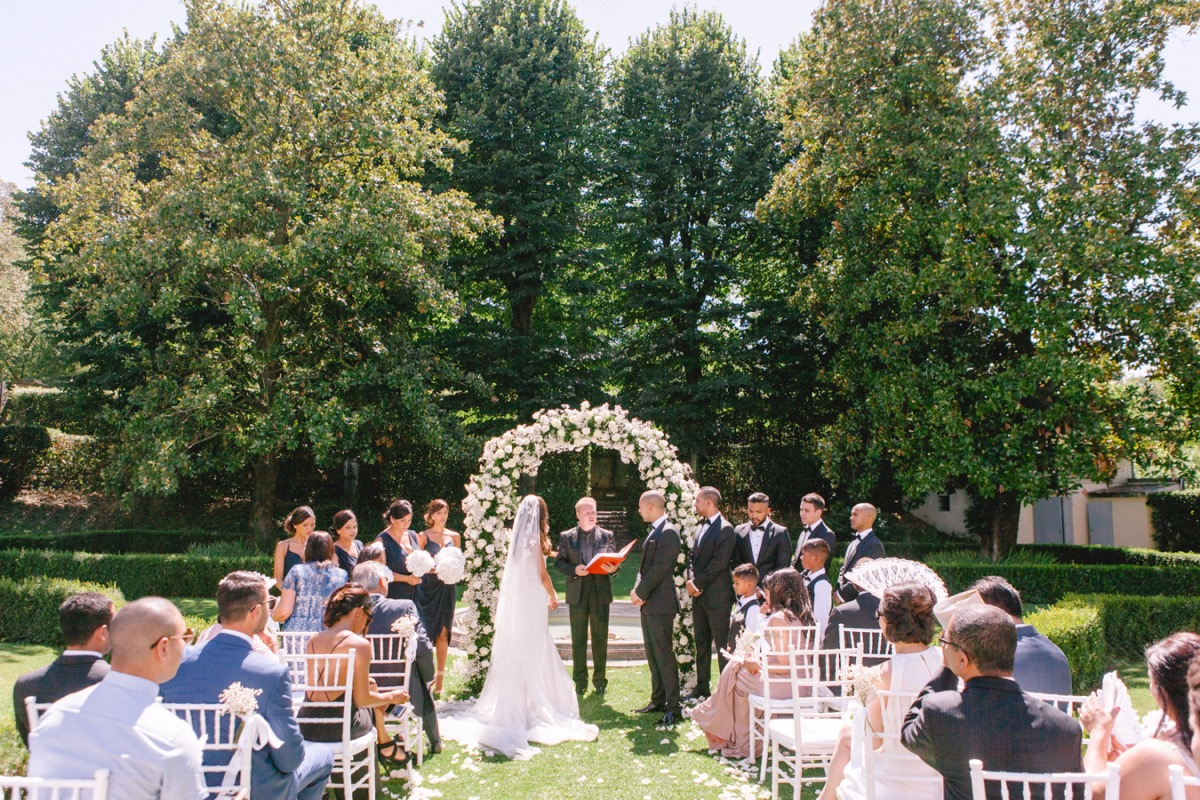 wedding_ceremony_outdoor_florence_white_floral_arch.jpg
