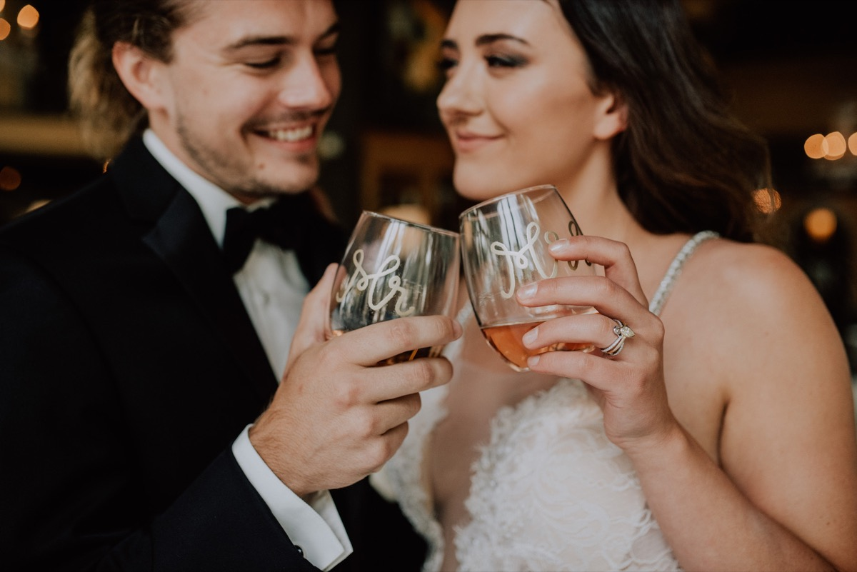 wedding_couple_cheers_mr_and_mrs_cups_gold_calligraphy.jpg