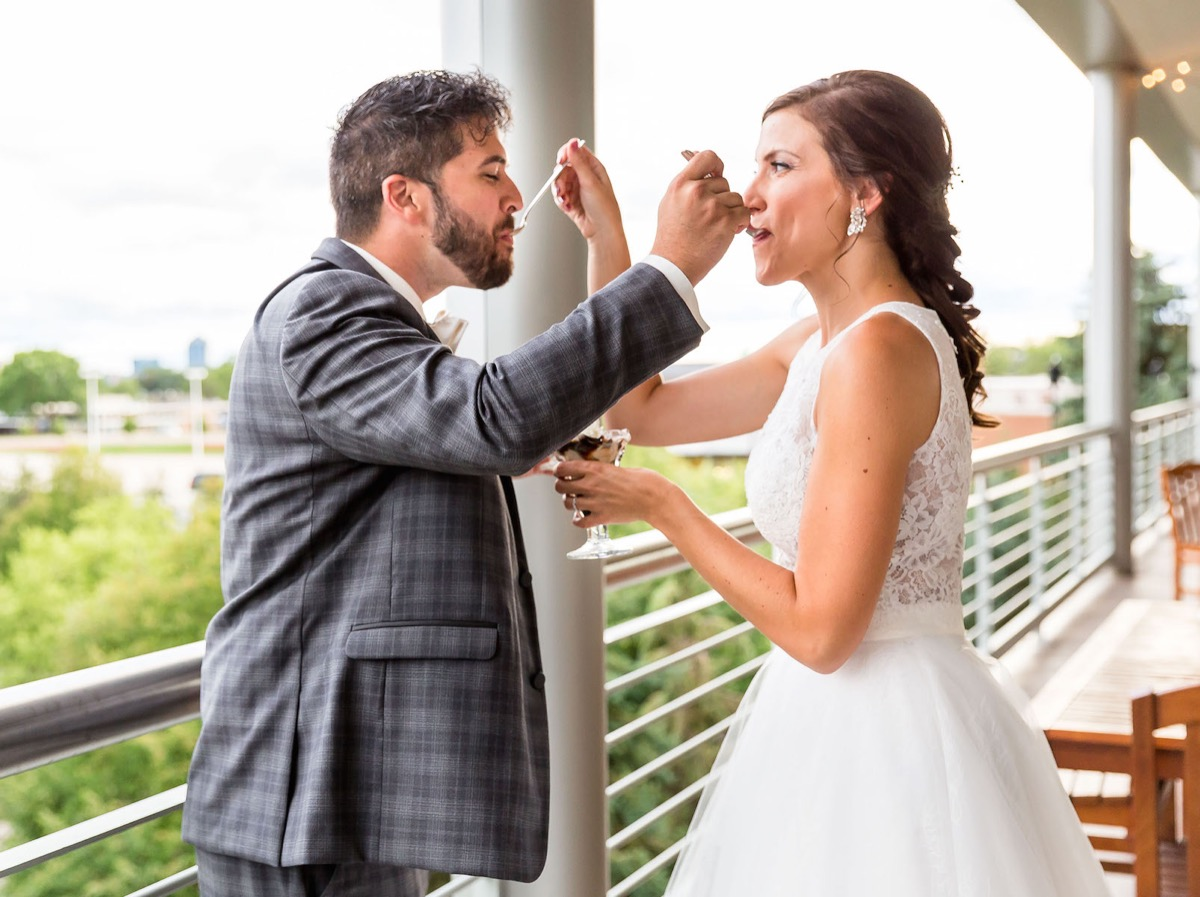 wedding_couple_feeding_each_other_ice_cream_bridgemans.jpg