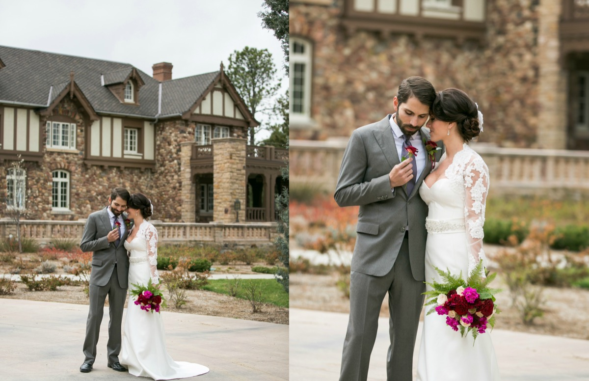 wedding_couple_in_love_outside_classy_brown_brick_venue_holding_bright_bouquet.jpg