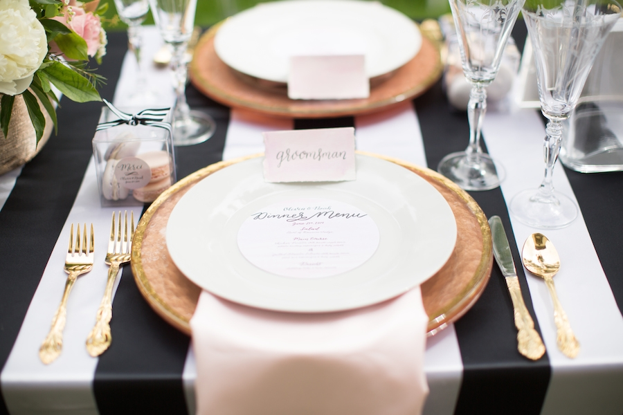 wedding_dinner_place_setting_black_and_white_tablecloth_gold_plates.jpg