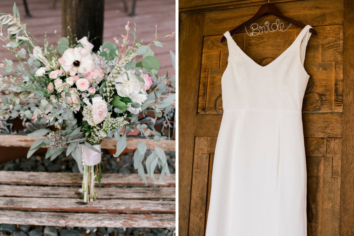 wedding_gown_hanging_on_bride_hanger_and_large_pink_white_bouquet.jpg