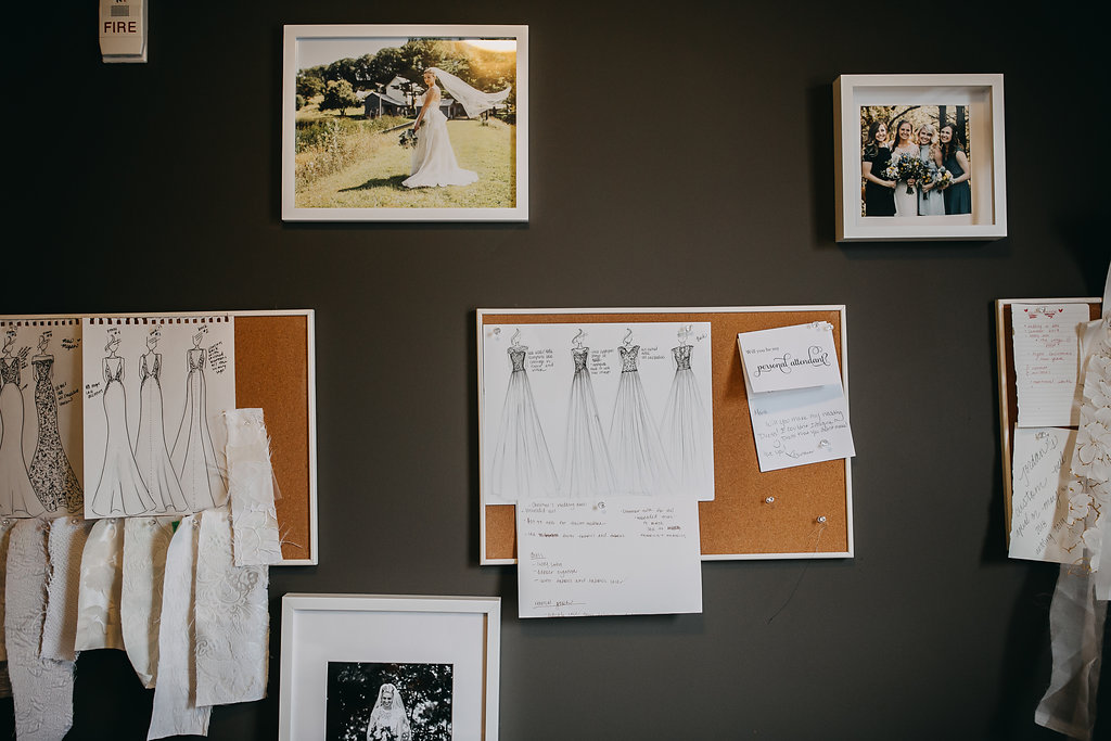 wedding_gown_sketches_pinned_on_wall.jpg