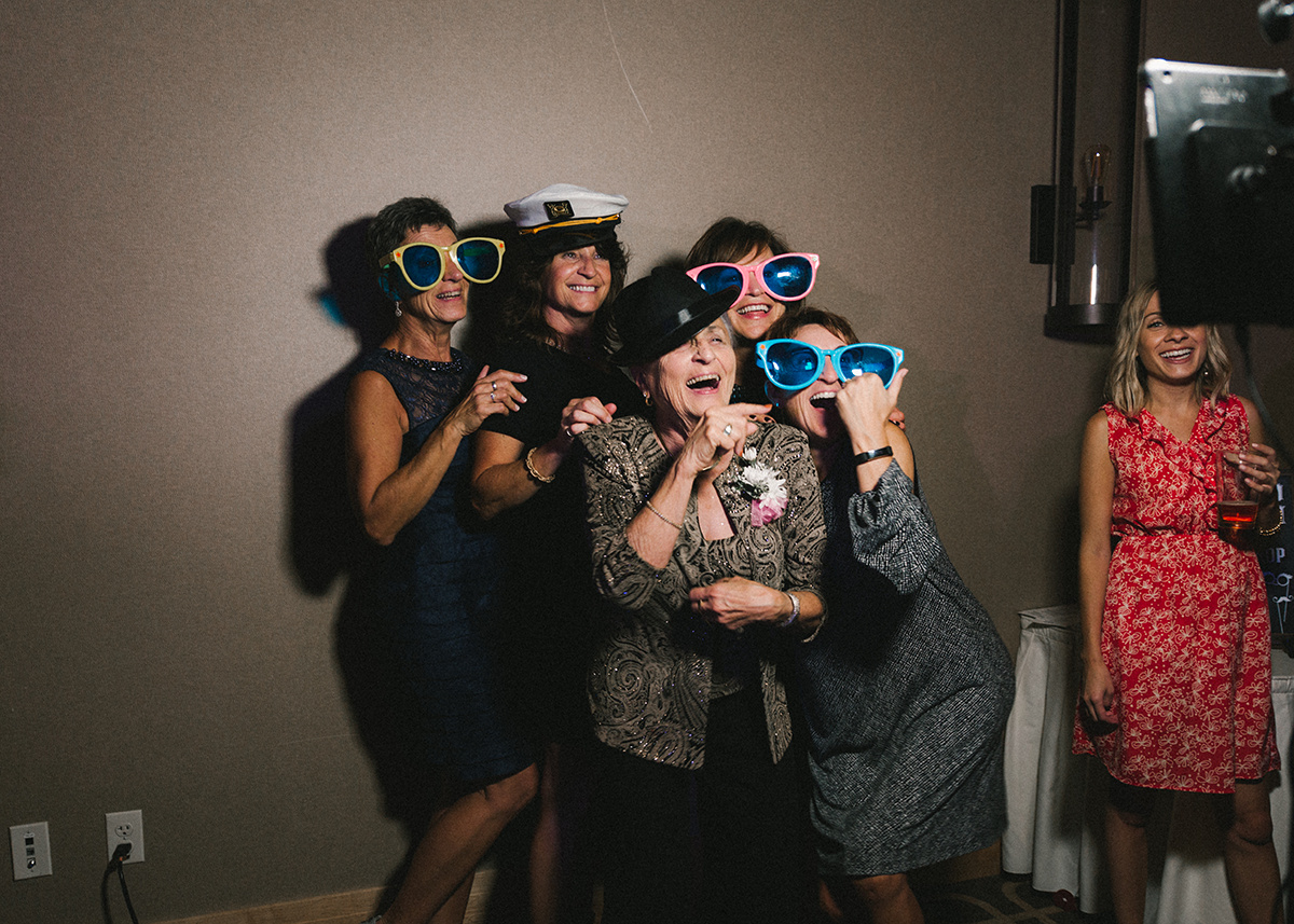 wedding_guests_having_fun_photo_booth.jpg